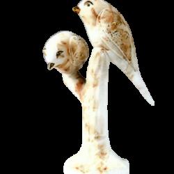 Deux oiseaux en céramique et or de 23k sur l'arbrede Pauline Pelletier